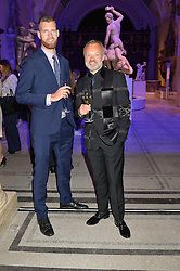 Left to right, ANDREW SMITH and GRAHAM NORTON at a private view of Alexander McQueen's Savage Beauty exhibition hosted by Samsung BlueHouse at the V&A, London on 30th March 2015.