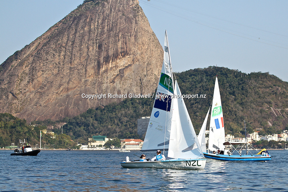 Jo Aleh and Polly Powrie wait for the breeze ahead of their Medal Race, with the Sugarloaf landmark in the background.<br /> Copyright photo: Richard Gladwell / www.photosport.nz