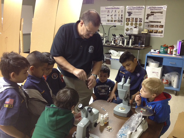 Mr. Chasteen working with a group of boy scouts.