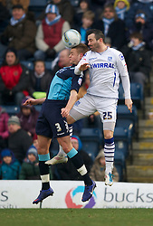 WYCOMBE, ENGLAND - Saturday, February 4, 2012: Tranmere Rovers' Martin Devaney in action against Wycombe Wanderers' Louis Laing during the Football League One match at Adams Park. (Pic by David Rawcliffe/Propaganda)