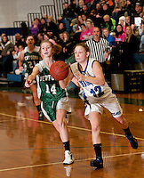 Newfound's Amber Plummer and Winnisquam's McKenzie Lonergan charge down court during the championship game of the 38th annual Holiday Basketball Tournament at Gilford High School Thursday evening.  (Karen Bobotas/for the Laconia Daily Sun)