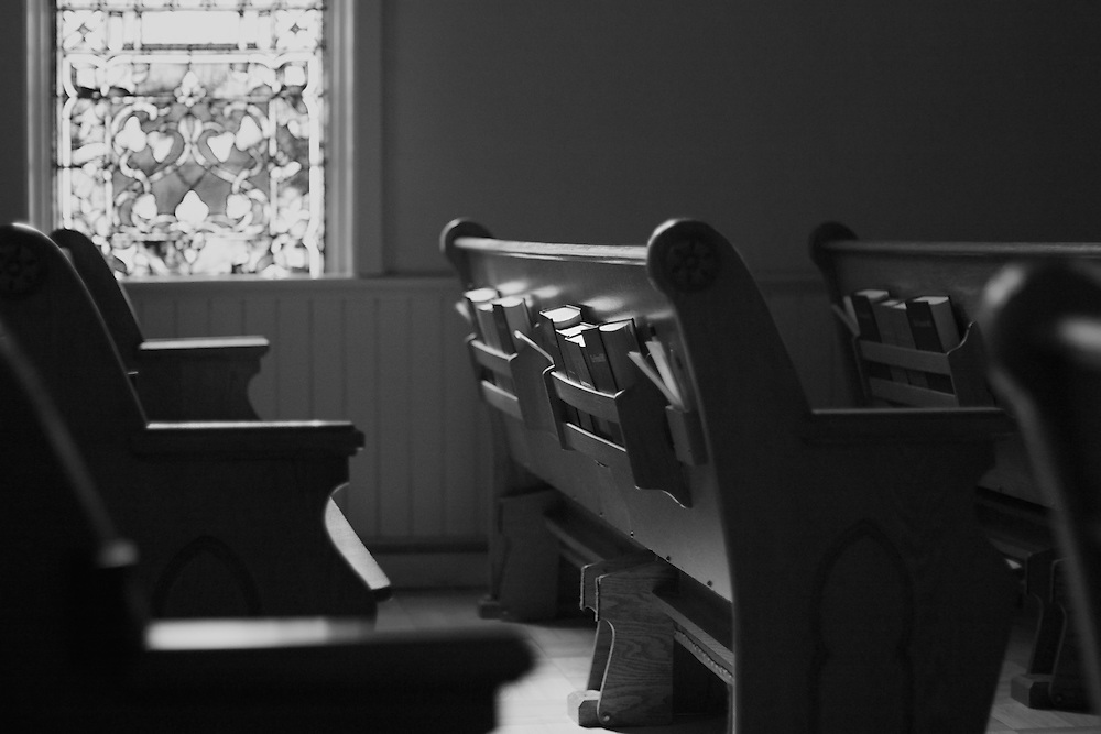 Sanctuary, pews, and stained glass window, rendered in black and white.