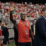 Former US olympian and University of Houston graduate, Carl Lewis, waves to the crowd prior to the game.<br /> <br /> Todd Spoth for The New York Times.