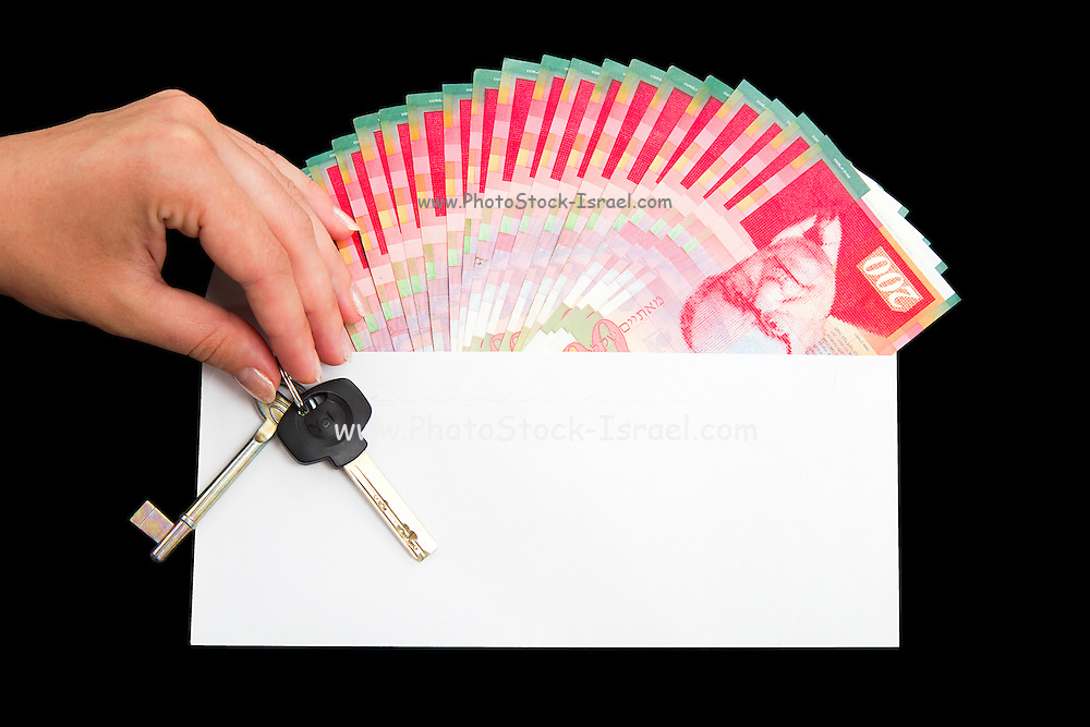 White envelope with cash money and key, bills of NIS200 on a black background