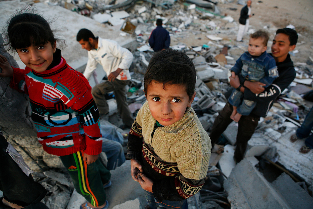 Palestinian children stand on top of their home destroyed by Israel in Jabaliya in the Gaza Strip.