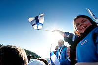 A crowd of fans from Finland cheer athletes during the ski jump medals round at the 2010 Olympic Winter Games in Whistler, BC Canada.