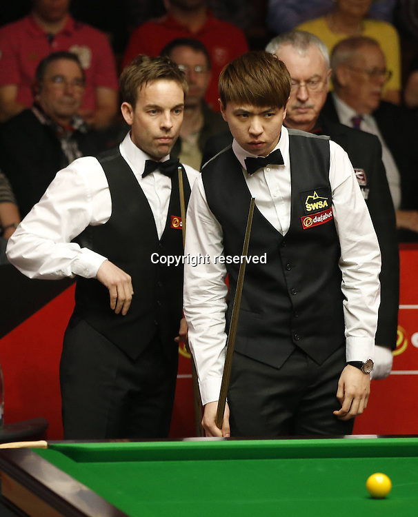 21.04.2014. Sheffield, England.  Xiao Guodong(R) of China looks on during his Round 1 match against  Allister Carter (Eng) on Day 2 of World Snooker Championship at the Crucible Theatre in Sheffeild, Britain, April 20, 2014. Xiao lost 8-10.
