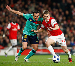 16.02.2011, Emirates Stadium, London, ENG, UEFA CL, FC Arsenal vs FC Barcelona, im Bild Arsenal's Jack Wilshere WITH Barcelona's Xavi (1? vice-captain) in Arsenal vs Barcelona for the UCL  ,Round of last 16, at the Emirates Stadium in London on 16/02/2011, EXPA Pictures © 2011, PhotoCredit: EXPA/ IPS/ Kieran Galvin +++++ ATTENTION - OUT OF ENGLAND/GBR and France/ FRA +++++