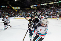 KELOWNA, CANADA - APRIL 22: Tyson Baillie #24 of Kelowna Rockets is checked by a player of the Seattle Thunderbirds on April 22, 2016 at Prospera Place in Kelowna, British Columbia, Canada.  (Photo by Marissa Baecker/Shoot the Breeze)  *** Local Caption *** Tyson Baillie;