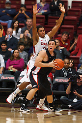 Nov 28, 2011; Stanford CA, USA;  Pacific Tigers forward Trevin Harris (1) is defended by Stanford Cardinal forward Josh Huestis (24) during the first half at Maples Pavilion. Stanford defeated Pacific 79-37. Mandatory Credit: Jason O. Watson-US PRESSWIRE