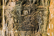 """02 JULY 2013 - ANGKOR WAT, SIEM REAP, SIEM REAP, CAMBODIA:  Bas relief stone carving on the wall inside Bayon, one of the temples in the Angkor complex. Angkor Wat is the largest temple complex in the world. The temple was built by the Khmer King Suryavarman II in the early 12th century in Yasodharapura (present-day Angkor), the capital of the Khmer Empire, as his state temple and eventual mausoleum. Angkor Wat was dedicated to Vishnu. It is the best-preserved temple at the site, and has remained a religious centre since its foundation– first Hindu, then Buddhist. The temple is at the top of the high classical style of Khmer architecture. It is a symbol of Cambodia, appearing on the national flag, and it is the country's prime attraction for visitors. The temple is admired for the architecture, the extensive bas-reliefs, and for the numerous devatas adorning its walls. The modern name, Angkor Wat, means """"Temple City"""" or """"City of Temples"""" in Khmer; Angkor, meaning """"city"""" or """"capital city"""", is a vernacular form of the word nokor, which comes from the Sanskrit word nagara. Wat is the Khmer word for """"temple grounds"""", derived from the Pali word """"vatta."""" Prior to this time the temple was known as Preah Pisnulok, after the posthumous title of its founder. It is also the name of complex of temples, which includes Bayon and Preah Khan, in the vicinity. It is by far the most visited tourist attraction in Cambodia. More than half of all tourists to Cambodia visit Angkor.         PHOTO BY JACK KURTZ"""