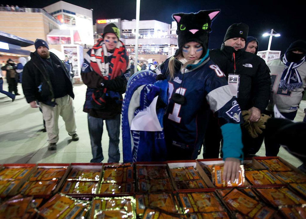Foxborough, MA 01/14/2012.Shelbie Ayotte of Connectictut picks up some of the 20,000 free handwarmers given out before the start of Saturday's AFC Divisional game between the Patriots and the Denver Broncos..Wicked Local Photo by Alex Jones