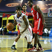 Delaware 87ers Guard Vander Blue (14) is fouled by Maine Red Claws Forward Chris Wright (33) as Blue drives towards the basket in the first half of an NBA D-league regular season basketball game between the Delaware 87ers (76ers) and the Maine Red Claws (Boston Celtics) Tuesday, Feb. 4, 2014 at The Bob Carpenter Sports Convocation Center, Newark, DE