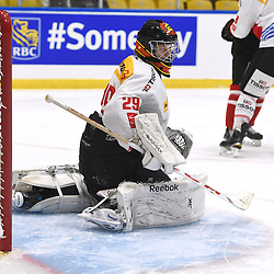 WHITBY, - Dec 13, 2015 -  WJAC Game 2- Team Switzerland vs Team Canada East at the 2015 World Junior A Challenge at the Iroquois Park Recreation Complex, ON. Philip WUthrich #29 of Team Switzerland protects the crease during the first period.<br /> (Photo: Andy Corneau / OJHL Images)