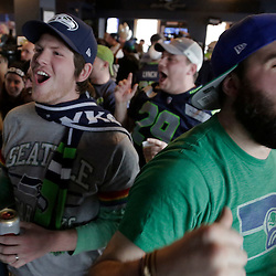 Seattle Seahawks fans watch Super Bowl XLVIII at the Hawk's Nest bar in Seattle, Washington February 2, 2014. The Seahawks meet the Denver Broncos for the big game Sunday in  East Rutherford, New Jersey.  REUTERS/Jason Redmond  (UNITED STATES)