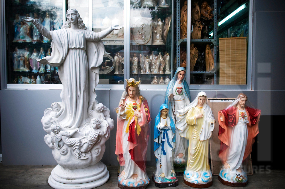 Figurines of the Christ and the Virgin Mary in a church shop, Ho Chi Minh city, Vietnam, Southeast Asia