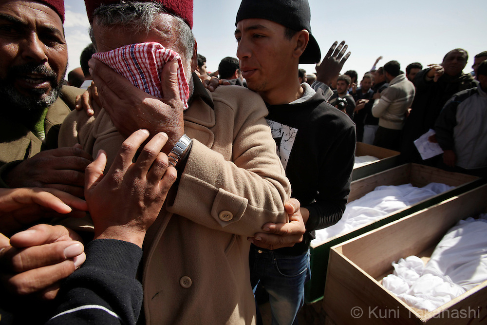 Relative mourn during funeral in Ajdabiya, Libya on March 3, 2011. Fourteen people were allegedly killed during a fight between rebel militia and Col. Muammar Gaddafi's military in Brega a day before..Photo by Kuni Takahashi
