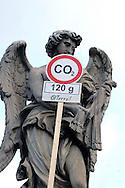 """Roma 5 Giugno 2008.  <br /> L' Associazione ambientalista  """"Terra""""  per protesta contro l'emissione di CO2, ha applicato  su 150 statue di Roma  mascherine antinquinamento e cartelli contro il CO2.<br /> Statua Ponte Sant'Angelo<br /> Rome June 5, 2008.  <br /> L 'Environmental association """"Earth"""" in protest against the emission of CO2, has applied to 150 statues of Rome anti-pollution masks and poster against the CO2."""