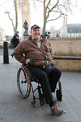 © Licensed to London News Pictures. 18/01/2017. LONDON, UK.  DOUG PAULLEY outside the Supreme Court in London, where he has just won an appeal judgement ruling that disabled travellers are legally entitled to priority use of wheelchair spaces on buses - even when they are being occupied by babies in buggies. The case brought by wheelchair user, Doug Paulley, from Wetherby, West Yorkshire was against the bus operator company, FirstGroup Plc.  Photo credit: Vickie Flores/LNP