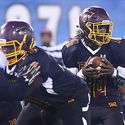 Milford quarterback TAYONE' MATTHEWS (10) attempts to handoff the ball during the 2017 DIAA Division II state championship game between the Delmar and Milford Saturday, Dec. 02, 2017 at Delaware Stadium in Newark, DE.