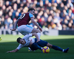 Harry Winks of Tottenham Hotspur (Front) and Ashley Barnes of Burnley in action - Mandatory by-line: Jack Phillips/JMP - 23/02/2019 - FOOTBALL - Turf Moor - Burnley, England - Burnley v Tottenham Hotspur - English Premier League