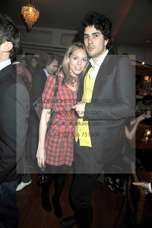 OLIVIA SCOTT-WEBB and RUPERT HUMPHRIES son of Barry Humphries at a party to celebrate the opening of Barts, Sloane Ave, London on 26th February 2009.