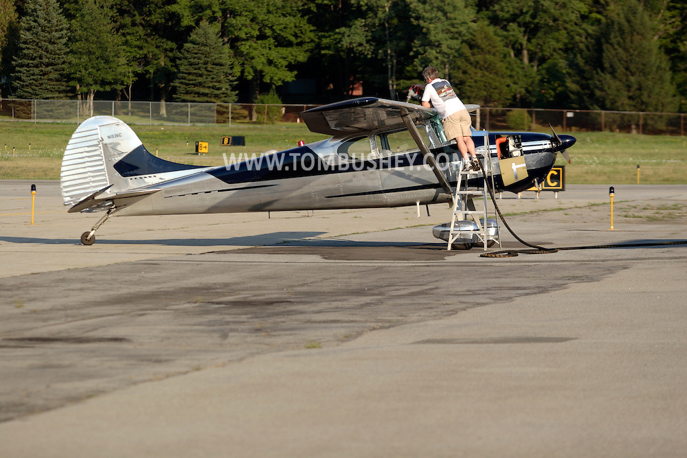 Montgomery, NY - A pilot fuels his Cessna 170B single-engine plane on the runway at Orange County Airport on July 25, 2008.