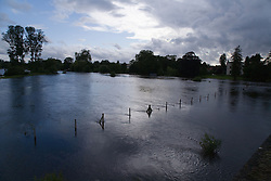 Countryside submerged under water after torrential rain caused flooding in Oxford and the Thames Valley area; July 2007,