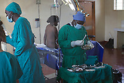 Doctor Ivan Nyenje (left) preparing for a caesarean section at Kasangati Health Centre in Uganda.