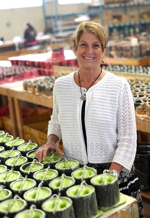 Warm Glow Candle Company owner Jackie Carberry..Chris Bergin/ The Star Press