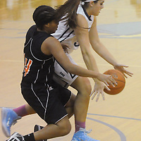 Hoggard's Aleah Thompson is fouled by New Hanover's Tanasia Toomer Friday December 12, 2014 at Hoggard High School in Wilmington, N.C. (Jason A. Frizzelle)