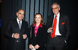 Left to right, The SWISS AMBASSADOR ALEXIS P LAUTENBERG  former tennis champion MARTINA HENGIS and MR MICHAEL RINGIER at a reception and buffet-dinner hosted by H.E.Alexis P.Lautenberg, Ambassador of Switzerland to celebrate British-Swiss friendship and the forthcoming 'UN International Year of Sport and Physical Education 2005' at 40 St.Mary Axe (The Gherkin) London EC3 on 13th December 2004.<br /><br />NON EXCLUSIVE - WORLD RIGHTS