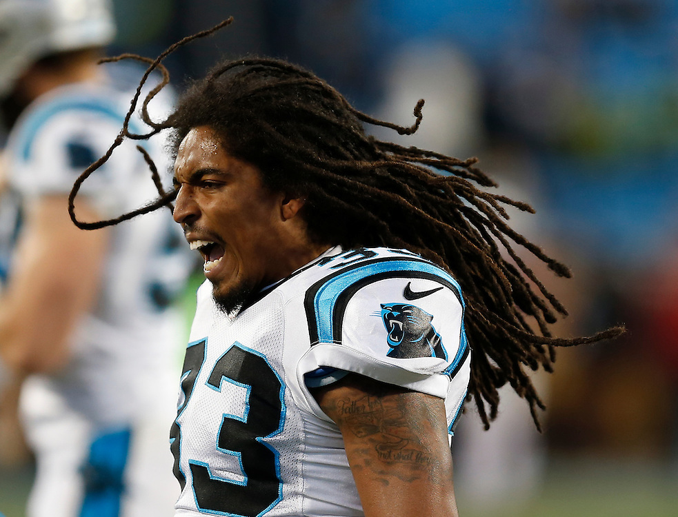 CHARLOTTE, NC - JAN 24:  Safety Tre Boston #33 of the Carolina Panthers sings during pre game warm ups before the NFC Championship game against the Arizona Cardinals at Bank of America Stadium on January 24, 2016 in Charlotte, North Carolina.
