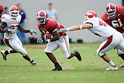 Alabama Crimson Tide running back Kenneth Darby avoids a tackle by Arkansas Razorback linebacker Clarke Moore during a 24 to 13 win over the Razorbacks on September 24, 2005 at Bryant-Denny Stadium in Tuscaloosa, Alabama..Mandatory Credit: Wesley Hitt/Icon SMI