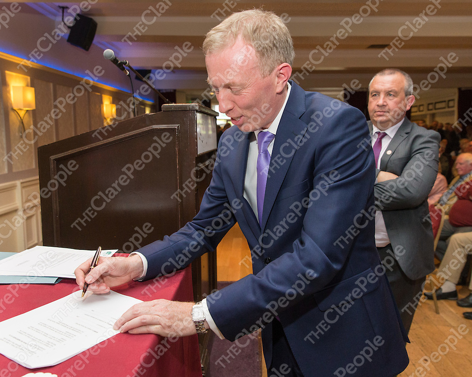 Timmy Dooley signing the Fianna Fail candidate pledge at the Co. Clare Nomination Conference