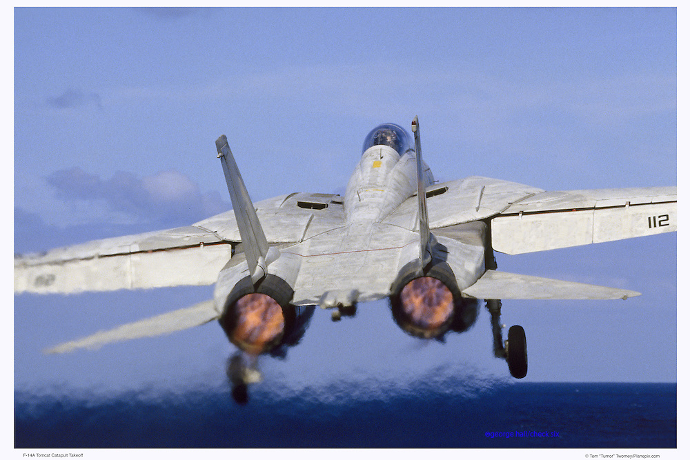 F-14 in full afterburner, taking off from aircraft carrier