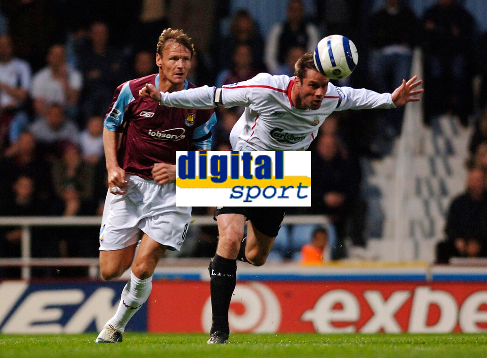 Photo: Daniel Hambury.<br />West Ham United v Liverpool. The Barclays Premiership. 26/04/2006.<br />West Ham's Teddy Sheringham is beaten to the ball by  Liverpool's Jamie Carragher.