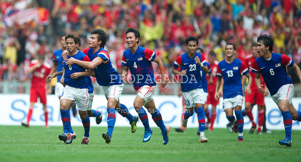 KUALA LUMPUR, MALAYSIA - Saturday, July 16, 2011: Malaysia XI's captain Shafiq Rahim celebrates scoring the first goal against Liverpool at the National Stadium Bukit Jalil in Kuala Lumpur on day six of the club's Asia Tour. (Photo by David Rawcliffe/Propaganda)