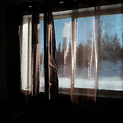 A snowy ladscape lies beyond a bedroom window at a resident's home at the Ochiichagwe'Babigo'Ining Ojibway Nation reserve (also known as the Dalles First Nation) in Northern Ontario, Canada on 22 December 2016.