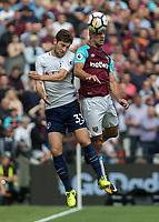Football - 2017 / 2018 Premier League - West Ham United vs Tottenham Hotspur<br /> <br /> Pablo Zabaleta (West Ham United)  beats Ben Davies (Tottenham FC)  to the header at the London Stadium<br /> <br /> COLORSPORT/DANIEL BEARHAM