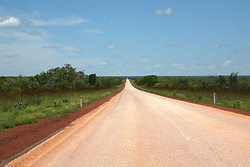 Cane grass lines the roadside on the main highway between Derby and Fitzroy Crossing in the wet season.