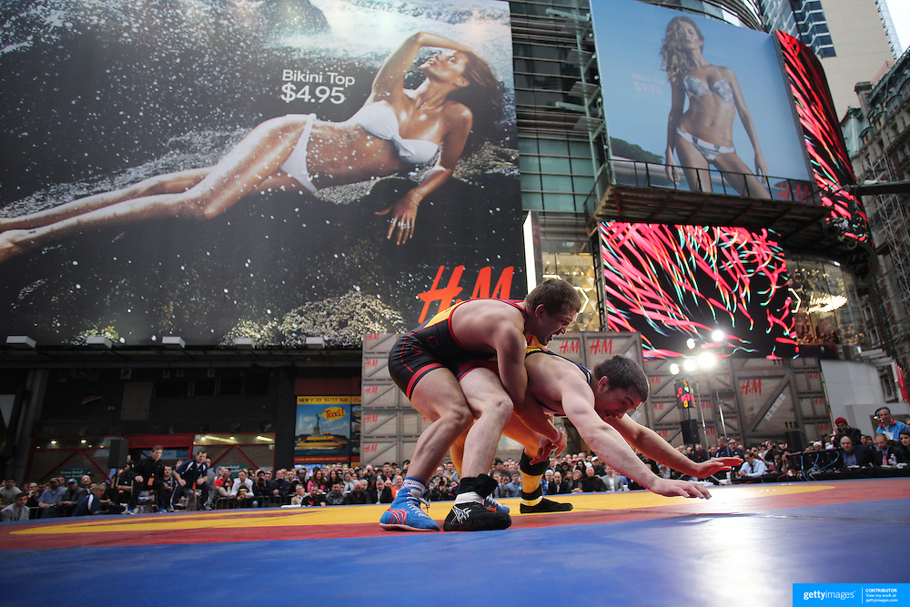Brent Metcalf, (right), USA, in action against  Magomed Kurbanaliev, Russia, during the 'Beat The Streets' USA Vs The World, International Exhibition Wrestling in Times Square. New York, USA. 7th May 2014. Photo Tim Clayton