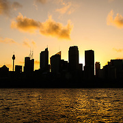 Silhouette of Sydney's city skyline as seen from from Mrs. Macquarie's Point at sunset
