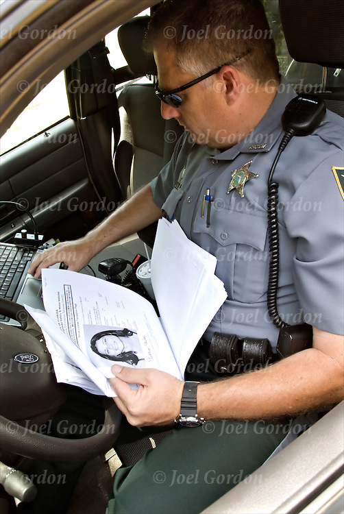 Deputy Sheriff - Warrenat Officer reviews outstanding warrants in car.Officer is assigned to Jail Corrections  - Pro-Active .  Warrants could be for Child Support, / DWLSR or for Sexual Battery.  teaming up with zone officers for the arrests .release # 2378