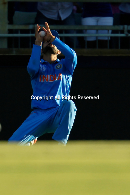 06.03.2015. Perth, Australia. ICC Cricket World Cup. India versus West Indies. Virat Kholi takes a catch to dismiss Jason Holder.