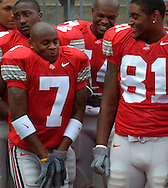 Ted Ginn Jr., front left, gets a little ornery while waiting to be photographed during photo day.