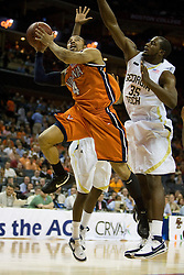Virginia guard Calvin Baker (4) shoots past Georgia Tech forward Zach Peacock (35).  The Virginia Cavaliers fell to the Georgia Tech Yellow Jackets 94-76  in the first round of the 2008 ACC Men's Basketball Tournament at the Charlotte Bobcats Arena in Charlotte, NC on March 13, 2008.