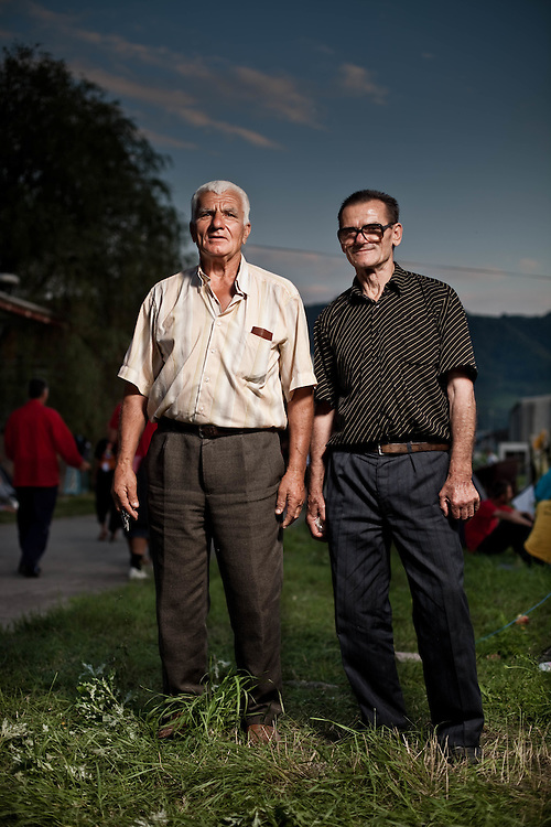 Portraits of walkers: Potocari, Bosnia and Herzegovina, 10 July 2010.<br /> Ljub Beslagjć, 67 years old and Kaplan Sulejman, 65 years old from Visoko.<br /> <br /> POn July 8 2010 more than 2,500 Peace March participants left Nezuk and walk 110 km before arriving in Potocari, near Srebrenica, on July 10. The Peace March has been organized to honour those Srebrenica residents who fled through the woods in July 1995 in an attempt to reach territory controlled by the Army of Bosnia and Herzegovina avoid being massacred by Bosnian Serb troops. Apart from participants from Bosnia, people from the Netherlands, Croatia, France, Switzerland, Serbia, Italy, the USA, Australia and other countries took part to the march.