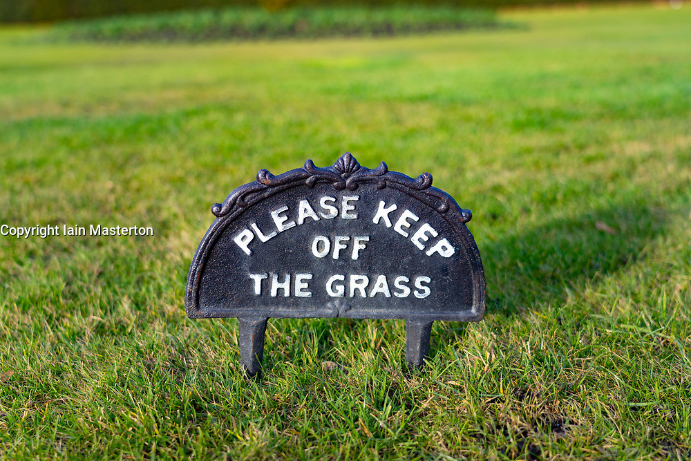 Keep of the Grass sign on a lawn
