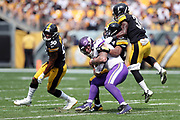 Minnesota Vikings tight end Kyle Rudolph (82) gets gang tackled by airborne Pittsburgh Steelers cornerback Mike Hilton (31), Pittsburgh Steelers inside linebacker Ryan Shazier (50), and Pittsburgh Steelers strong safety Sean Davis (28) as Rudolph catches a second quarter pass for a gain of 11 yards and a first down during the 2017 NFL week 2 regular season football game against the against the Pittsburgh Steelers, Sunday, Sept. 17, 2017 in Pittsburgh. The Steelers won the game 26-9. (©Paul Anthony Spinelli)
